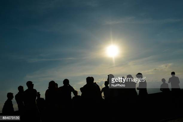People enjoy a view of a sunset from the Wawel Castle On Thursday August 17 in Krakow Poland