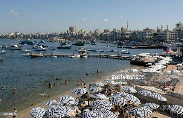 People enjoy an afternoon on the beach at a private club in the eastern harbor in Alexandria Egypt on Tuesday Aug 14 2007 After 15 years of hauling...