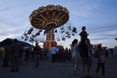 People enjoy an amusement park ride at Point Pleasant Beach on the first weekend of New Jersey beaches reopening to the public on May 27 2013 in...