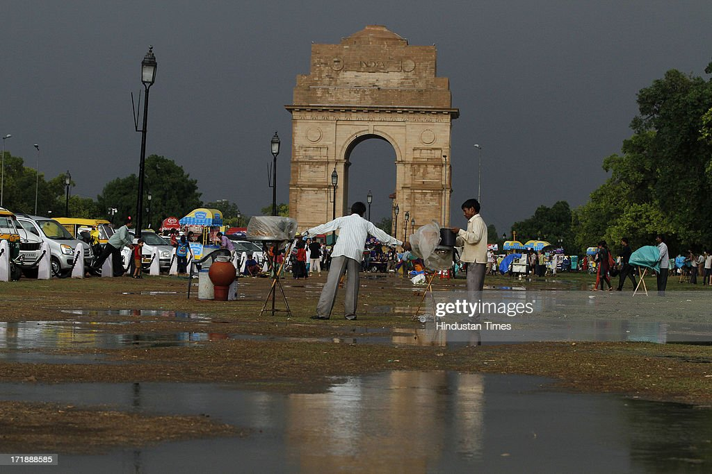People enjoy as weather turns pleasant at India Gate lawn, following rain on June 29, 2013 in New Delhi, India. Weather department forecast the country will receive normal rains this year, raising prospects of a stronger performance by Asia's third-largest economy.