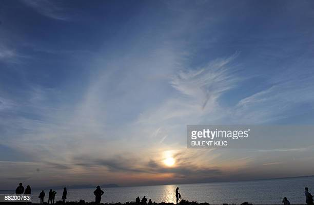 People enjoy at the seaside before the dawn service during the ceremony of the 94th anniversary of the Anzac Day in Canakkale on April 24 2009 The...