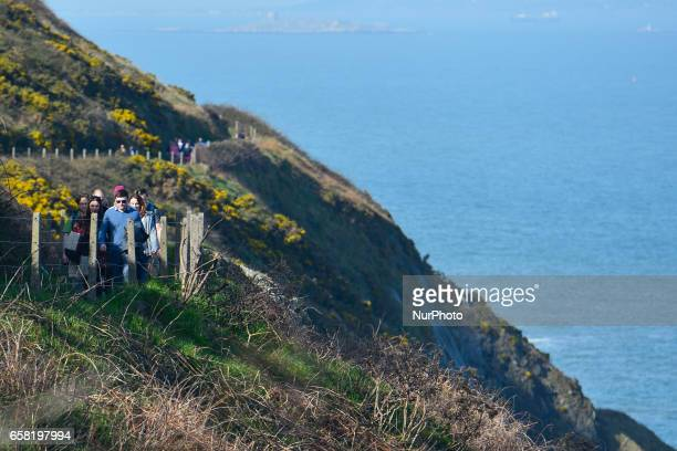 People enjoy BrayGreystones cliff walk On Sunday March 26 in Bray Ireland