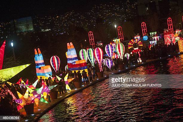 People enjoy Christmas show 'Luminasia' the biggest figures light show in Latin America in Monterrey Nuevo Leon on December 13 2104 AFP PHOTO/Julio...