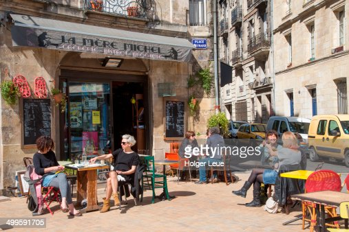 People enjoy coffee and wine outside creperie
