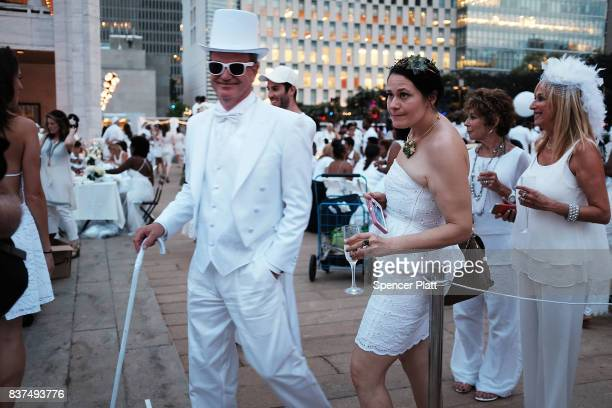 People enjoy dinner at the annual 'Diner en Blanc' at Lincoln Center on August 22 2017 in New York City Diner en Blanc began in France nearly 30...