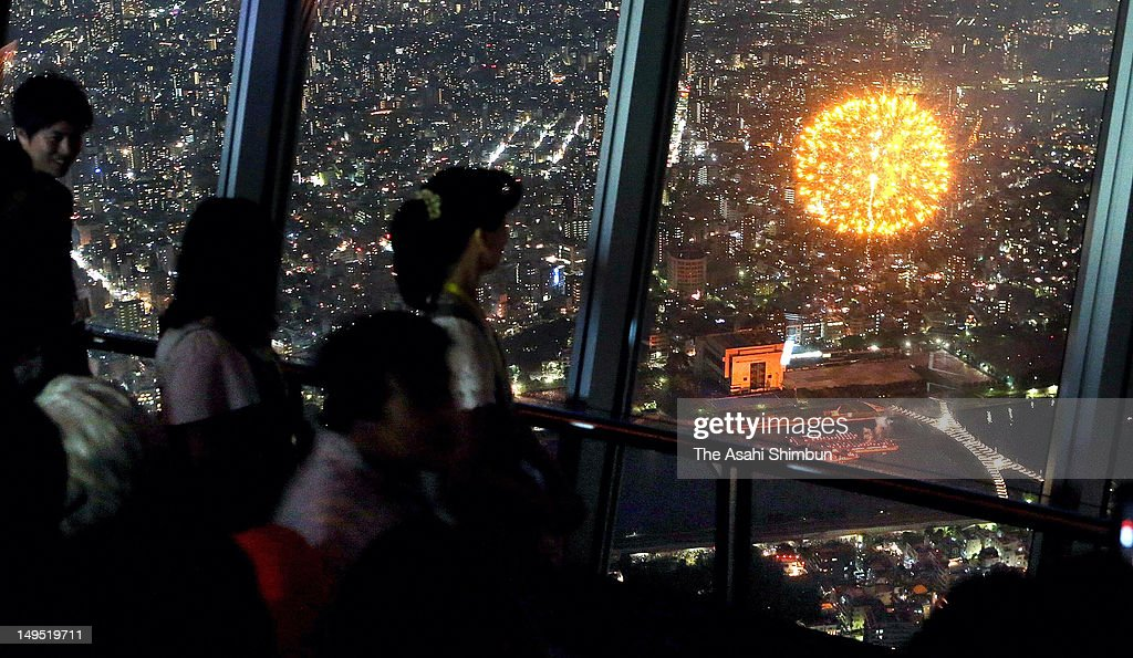 People enjoy fireworks from the Tokyo Skytree during the Sumida River Firework Festival on July 23, 2012 in Tokyo, Japan.