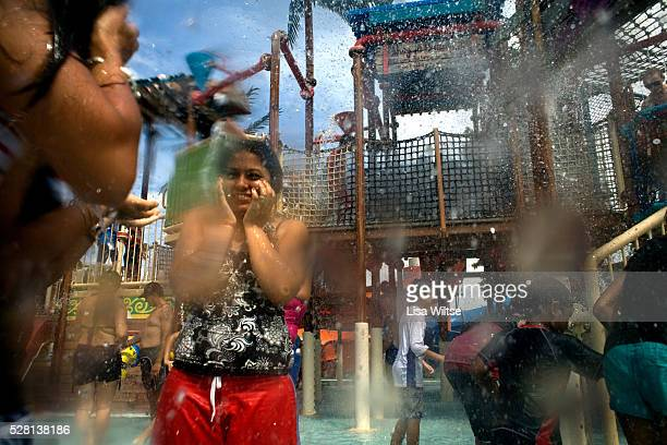 People enjoy getting drenched with fresh water in Buccaneer Bay at the Wet n' Wild theme park in the Gold Coast Queensland Australia on January 22...