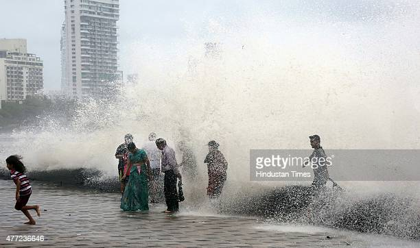 People enjoy high tide during monsoon season at Worli Seaface on June 15 2015 in Mumbai India Heavy rains caused major water logging in many areas...
