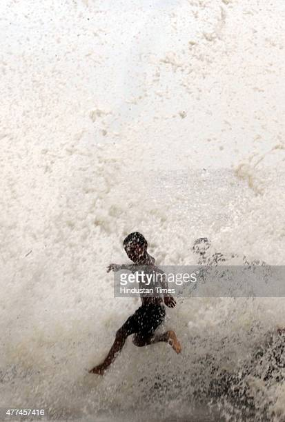People enjoy high tide during monsoon season at Worli Seaface on June 17 2015 in Mumbai India Heavy rains caused major water logging in many areas...