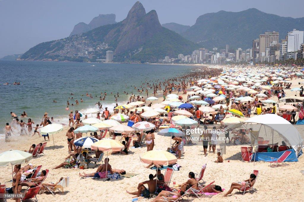 People enjoy Ipanema beach in Rio de Janeiro on December 27 2012 as the temperature rises over 40°C On the eve Rio de Janeiro reported a heat record...