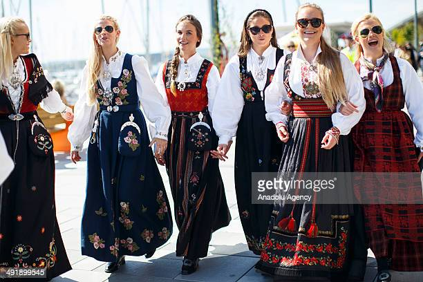 People enjoy Norwegian Constitution Day celebrations on May 17 2014 in Oslo Norway Norway's Constitution declaring the country to be an independent...