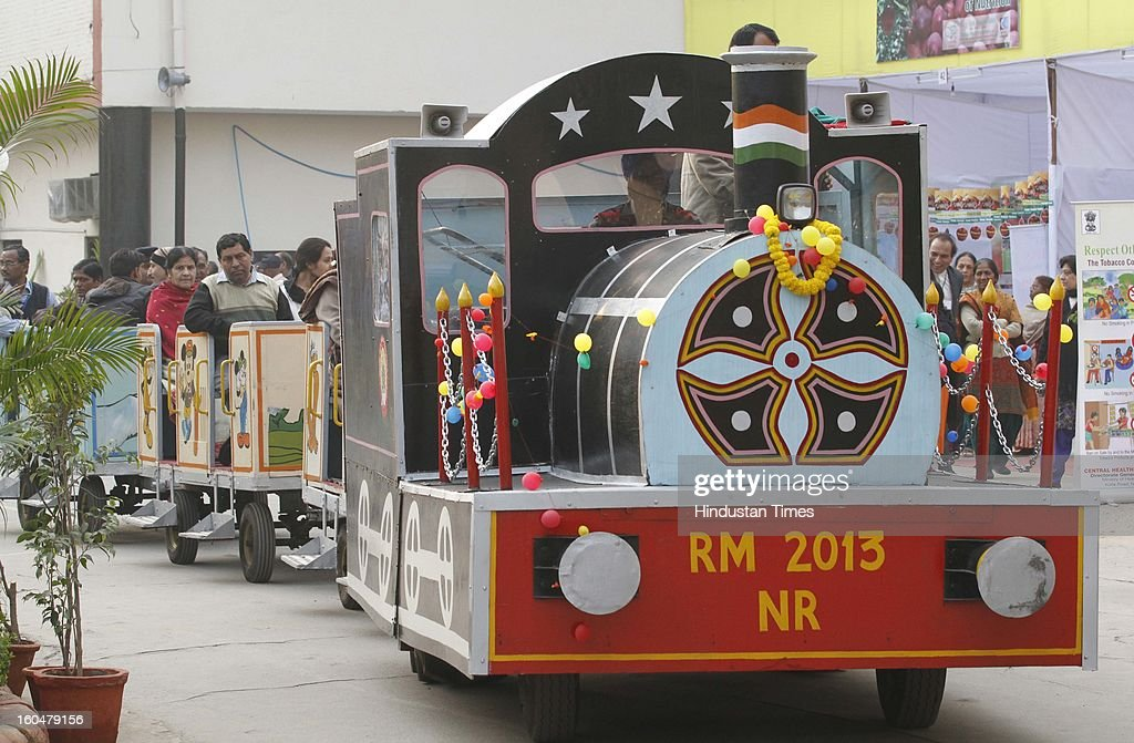 People enjoy ride in joy train during Northern railway's Rail Mela at Baroda house on Febraury 1, 2013 in New Delhi, India.