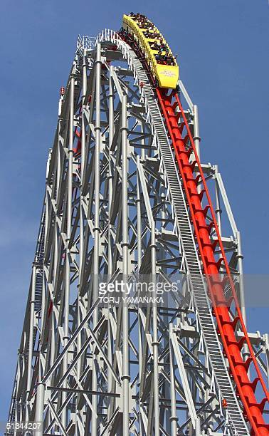 People enjoy riding down from the highest point of the world's highest and longest roller coaster 'Steel Dragon 2000' at Nagashima Spa Land in...