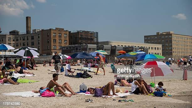 People enjoy Rockaway Beach during a heat wave on July 17 2013 in the Rockaway Beach neighborhood of the Queens borough of New York City Temperatures...