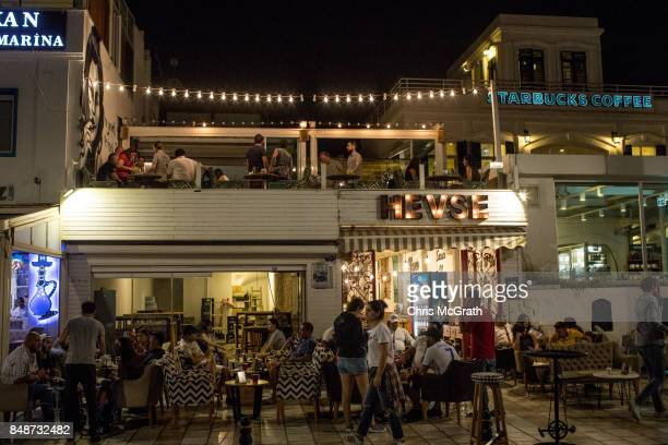 People enjoy shisha at a coffee shop on September 16 2017 in Bodrum Turkey Bodrum and the Bodrum Peninsula famous for being a celebrity and luxury...