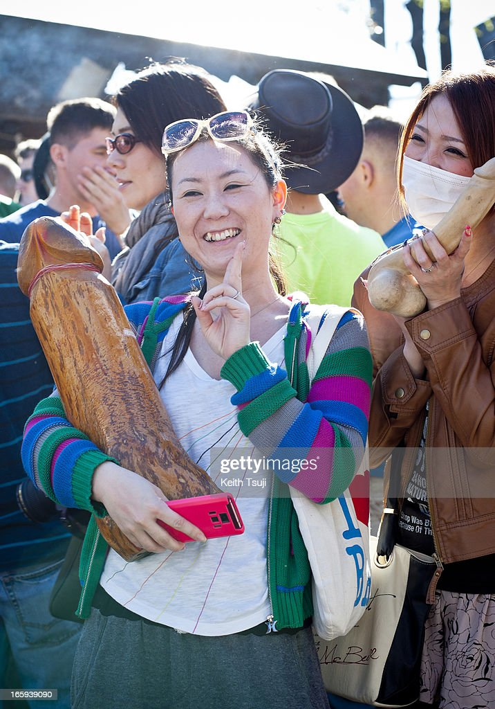 People enjoy taking photos with wooden phallic-shaped statue at Kanamara Matsuri (Festival of the Steel Phallus) on April 7, 2013 in Kawasaki, Japan. The festival is held annually on the first Sunday of April and it is centered around a local penis-venerating shrine once popular among prostitutes who wished to pray for protection from sexually transmitted diseases. The festival is now a popular tourist attraction.