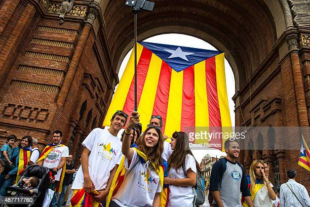 People enjoy the atmosphere before a Catalan ProIndependence demonstration celebrating the Catalan National Day on September 11 2015 in Barcelona...