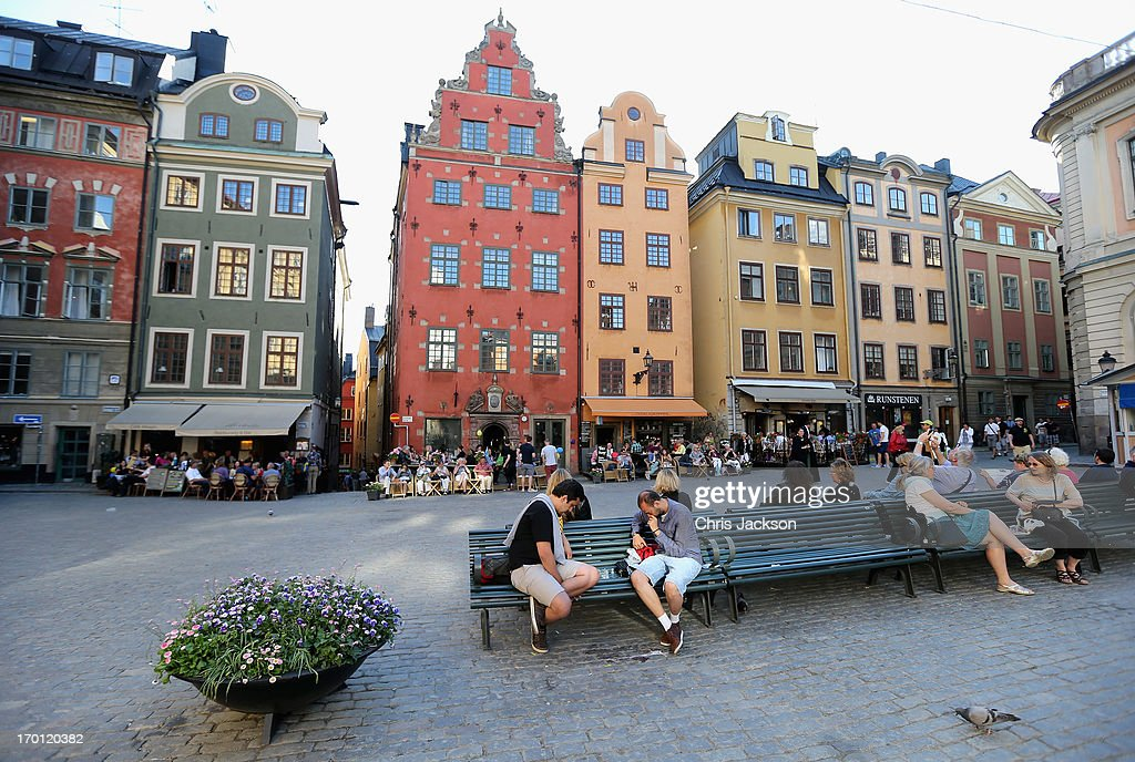 People enjoy the atmosphere in a city square as preparations for the wedding of Princess Madeleine of Sweden and Christopher O'Neill continues on June 7, 2013 in Stockholm, Sweden.