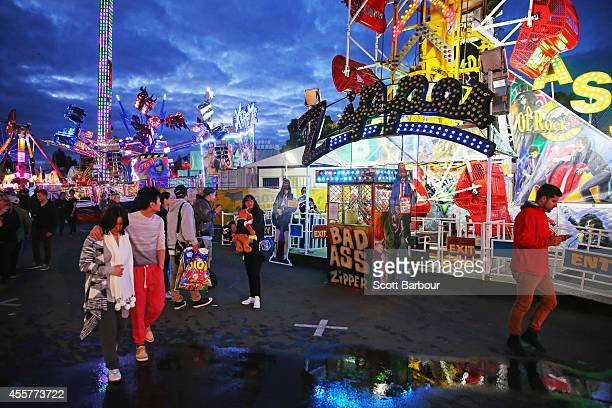 People enjoy the atmosphere in the Thrillseekers Carnival during the 159th annual Royal Melbourne Show at the Royal Melbourne Showgrounds on...