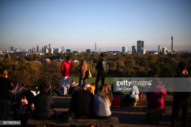 People enjoy the autumn weather on Primrose Hill on October 28 2014 in London England Warmer than usual weather has seen London temperatures rise to...