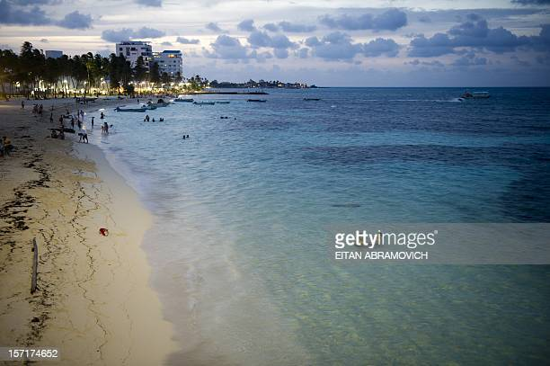 People enjoy the beach during sunset in San Andres Island Colombia on November 29 2012 Colombia on Wednesday said it would no longer recognize the...