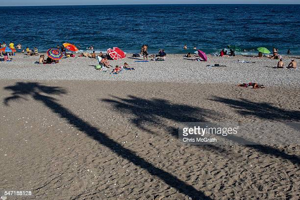 People enjoy the beach on July 11 2016 in Antalya Turkey Russian President Vladimir Putin last month officially lifted travel restrictions on tourism...