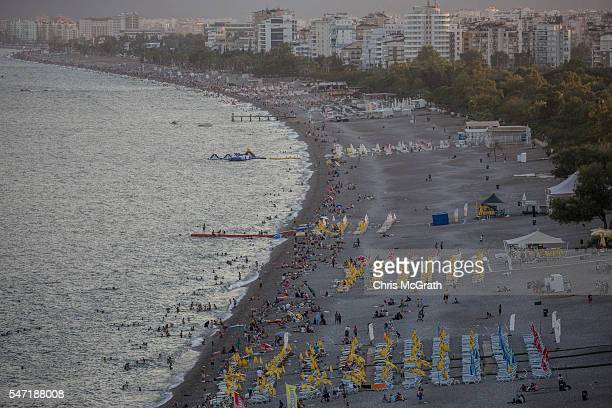 People enjoy the beach on July 13 2016 in Antalya Turkey Russian President Vladimir Putin last month officially lifted travel restrictions on tourism...