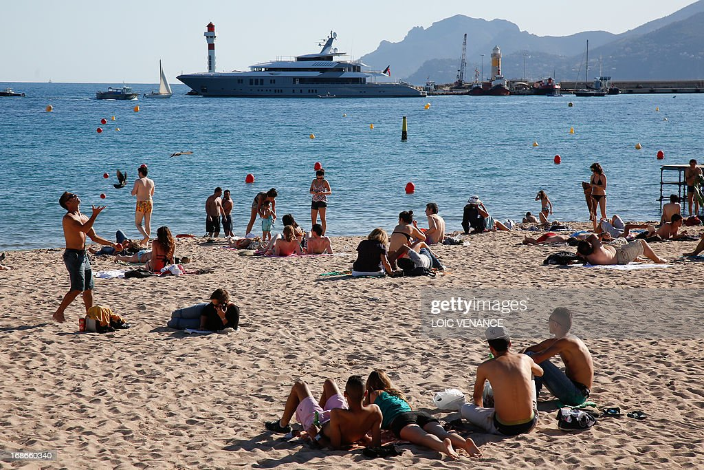 People enjoy the beach on May 13, 2013 in Cannes, two days before the opening of the 66th Cannes Film Festival.