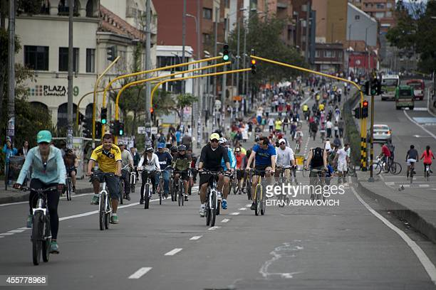 People enjoy the 'Ciclovia' by some Bogota's streets temporarily closed for motor vehicles and enabled for cyclists pedestrians and skaters on...