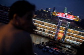 People enjoy the coolness in the night near by a luxurious boat restaurant along the Yangtze River on August 4 2013 in Chongqing China Chongqing is a...