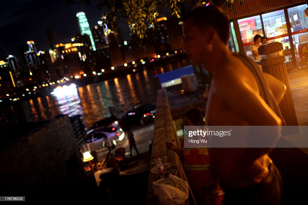 People enjoy the coolness in the night on August 4, 2013 in Chongqing, China. Chongqing is a major city in southwest China and became the municipality was created on 14 March 1997. It known as a 'Mountain City' and 'River City' was constructed on the mountain and along the Yangtze River.