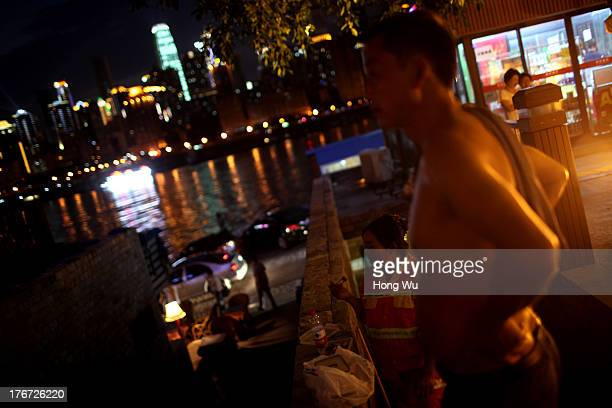 People enjoy the coolness in the night on August 4 2013 in Chongqing China Chongqing is a major city in southwest China and became the municipality...