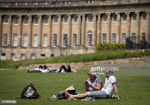 People enjoy the fine weather in front of the Royal Crescent in the Royal Victoria Park on June 5 2015 in Bath England After a unsettled start to...