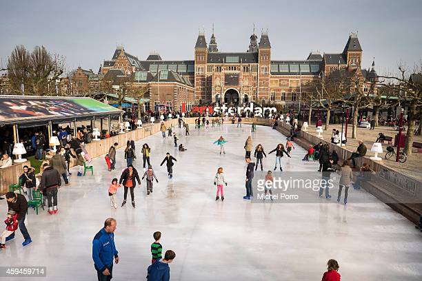 People enjoy the first weekend on the traditional ice skating rink outside the Rijksmuseum on November 23 2014 in Amsterdam Netherlands