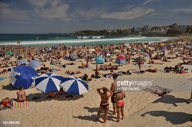 People enjoy the hot weather at Bondi Beach during the Labour Day holiday in Sydney on October 5 2015 AFP PHOTO / Peter PARKS