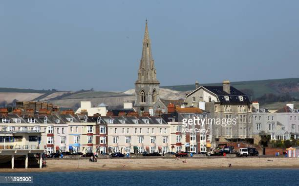 People enjoy the mild spring weather on the beach at Weymouth on April 8 2011 in Weymouth England Weymouth Bay and Portland Harbour is gearing up to...