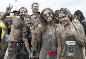 People enjoy the moment during the Boryeong Mud Festival in Daecheon Beach on July 16 2016 in Seoul South Korea