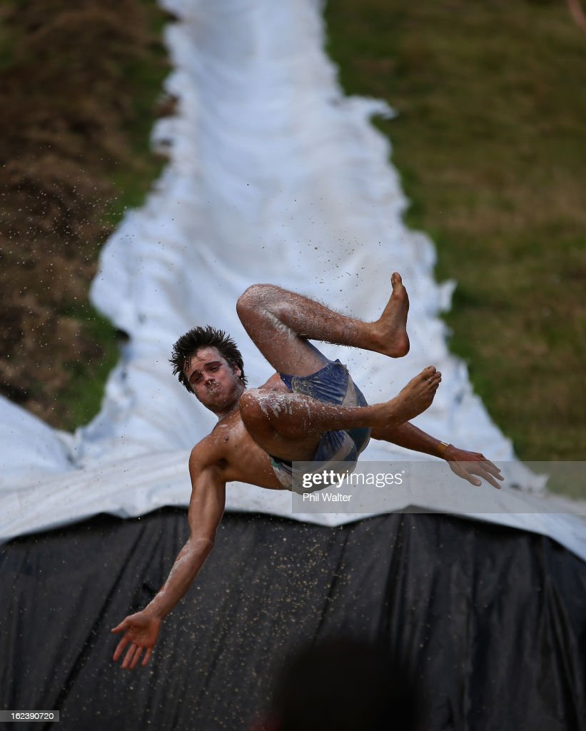 People enjoy the muddy thrills and spills on a waterslide dug into a hillside in Waimauku on February 23, 2013 in Auckland, New Zealand. Only 2000 people will have the honour of riding the water slides, with one measuring 650 meters long built by New Zealanders Jimi Hunt and Dan Drupstee, of the 'Live more Awesome' charity this weekend. The world's longest slide will be open for only two days to raise funds and awareness of depression.