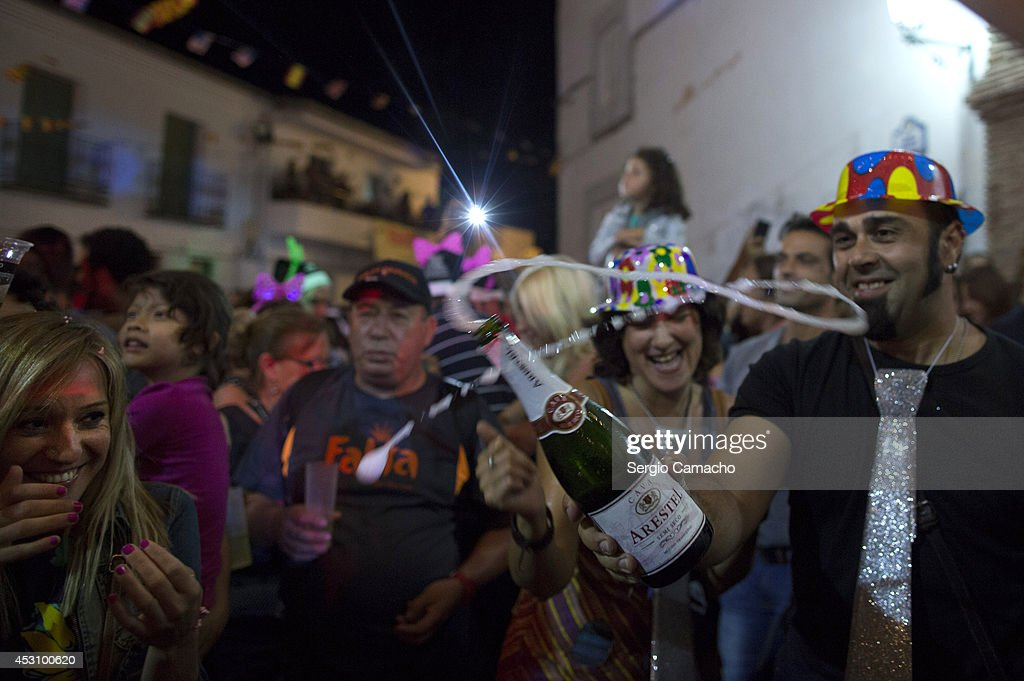 People enjoy the New Year's Eve in August celebrations on August 2, 2014 in Berchules, Spain. The town of Berchules, located in Granada, on the southern slope of the Sierra Nevada Mountain Range, has had a curious New Year's Eve tradition in place since 1994. The town experienced a power outage on New Year's eve in 1994 and residents were unable to hold the traditional celebrations, so they decided to move their celebrations to the mid-point of the year, holding them in August instead.