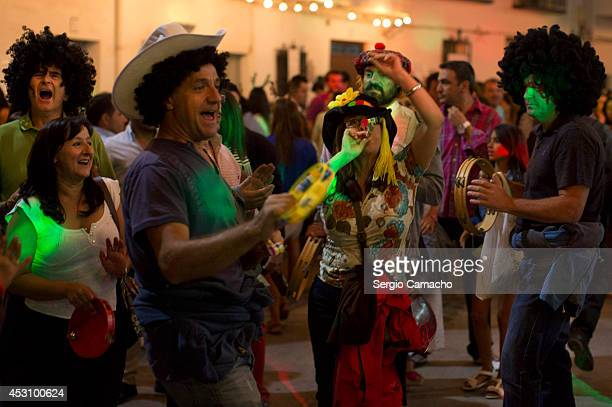 People enjoy the New Year's Eve in August celebrations on August 2 2014 in Berchules Spain The town of Berchules located in Granada on the southern...
