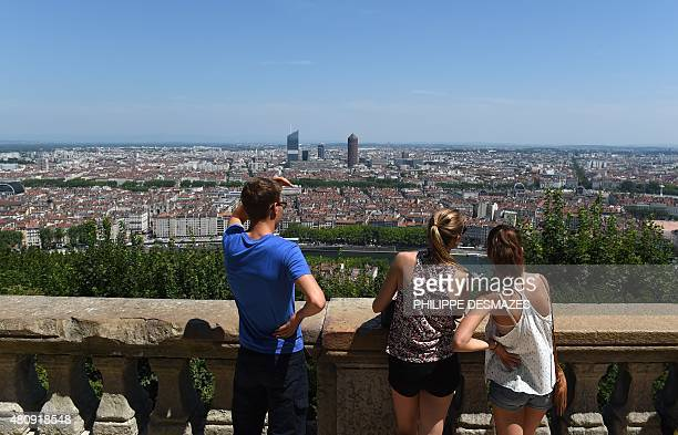People enjoy the panorama from the Fourviere basilica in Lyon France on July 16 during a heat wave with temperatures hitting nearly 40 degrees in the...