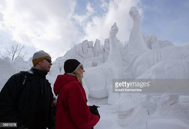 People enjoy the Sapporo Snow Festival during its opening day February 5 2004 in Sapporo Japan Most of the work to make the more than 300 snow...