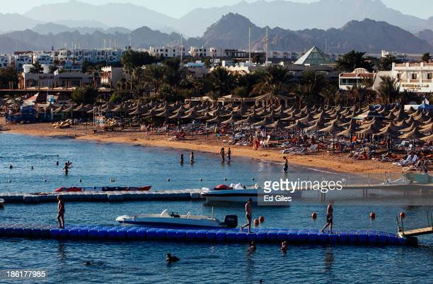 People enjoy the sea at a beach popular with tourists on October 26 2013 in the Red Sea resort town of Sharm El Sheikh Egypt Sharm elSheikh lying on...