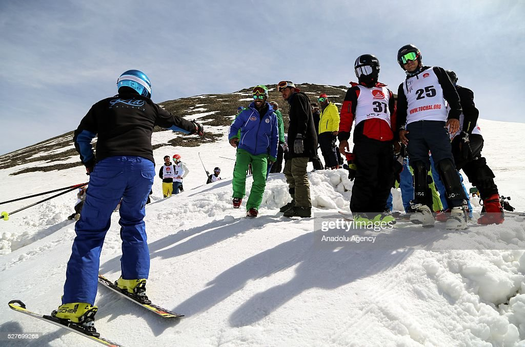 People enjoy the ski slopes at the ski resorts of Alborz mountain during a competition marking the end of the winter at Tochal ski resort north of the capital Tehran, Iran on May 3, 2016.