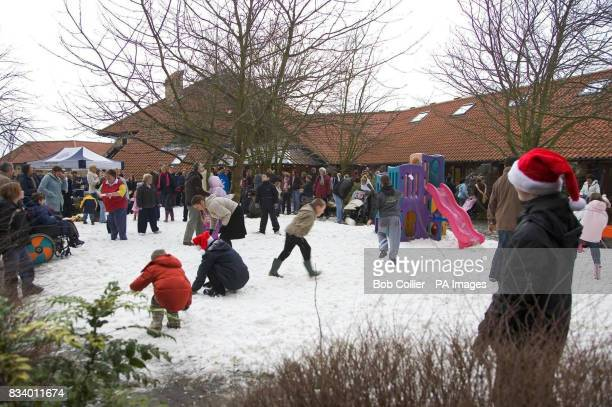 People enjoy the snow at Martin House children's hospice near Leeds after local businessman Chris Hopkins won a charity eBay auction for a white...
