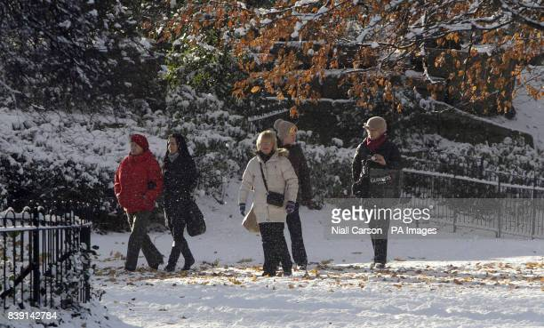 People enjoy the snow in St Stephens Green in Dublin as forecasters issued a weather warning and said the bitterly cold snap will continue for the...