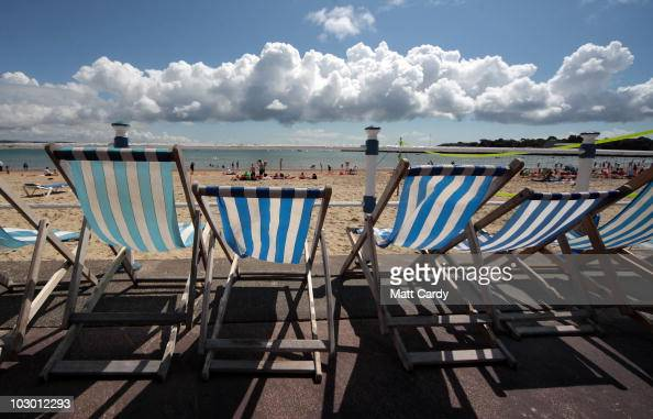 People enjoy the summer weather on the beach at the seafront on July 21 2010 in Weymouth England With many schools in England and Wales about to or...
