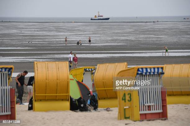 People enjoy the summertime on the beach in Cuxhaven western Germany on August 15 2017 / AFP PHOTO / PATRIK STOLLARZ