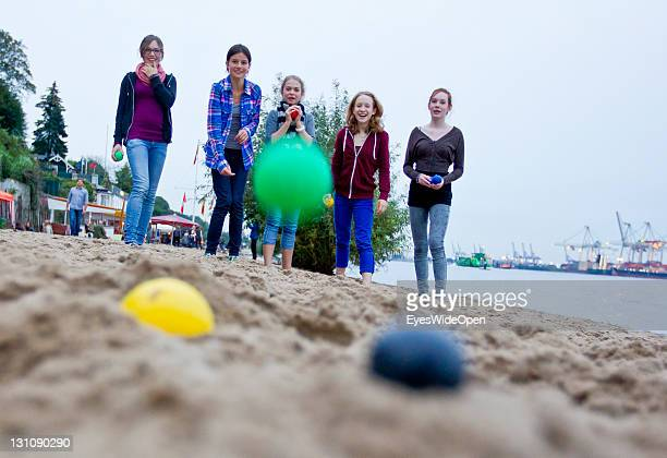 People enjoy the sun and play boccia at the beach Ovelgonne on the river Elbe on September 16 2011 in Hamburg GermanyThe beach has a beautiful view...