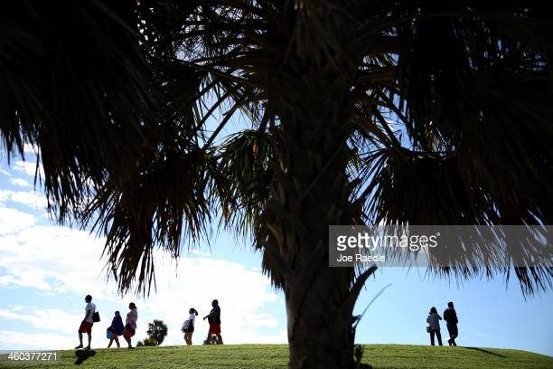 People enjoy the sun and warm weather on January 3 2014 in Miami Florida The population in the state of Florida will surpass New York state soon to...